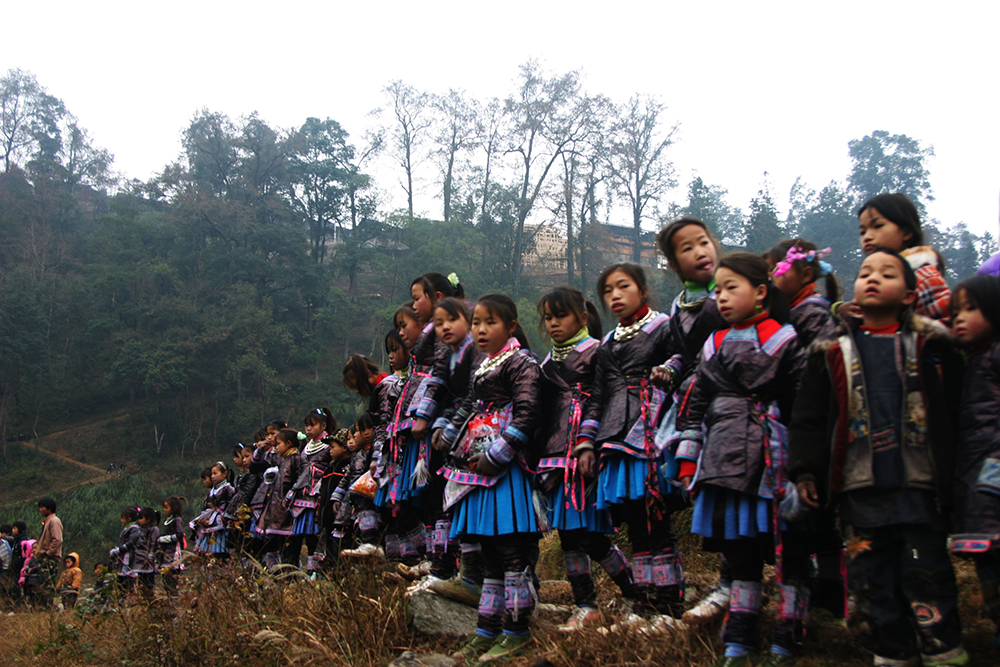 Kids from Black Miao of Gaodiao are at festival in the valley